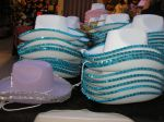 Lots of cowboy and cowgirl hats for sale.  Love the sequins.